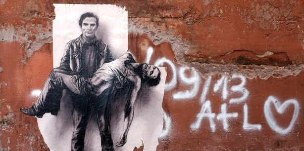 "A drawing on paper called ""Pasolini Pieta"" by French street artist Ernest Pignon-Ernest, dedicated to slain Italian film director Pier Paolo Pasolini, is seen at Via Dell'Arco de Cenci Jewish district in Rome on June 23, 2015. The poster pasted on the walls of many districts of Rome represents a Pasolini alive and dying, in an interpretation of the Pieta, in which the intellectual holds his own dead body. Pasolini was killed on November 2, 1975 near Rome. AFP PHOTO / ALBERTO PIZZOLI RESTRICTED TO EDITORIAL USE, MANDATORY MENTION OF THE ARTIST, TO ILLUSTRATE THE EVENT AS SPECIFIED IN THE CAPTION"